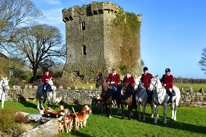 David Masterson huntsman of the North Galway Foxhounds with the masters Tom McNamara Michael Lennon and Jackie Lee with whipper in Gabriel Slattery at Shrule Castle built in 1238